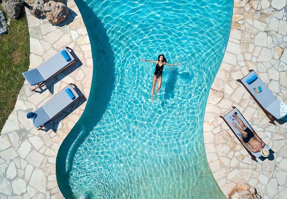 Amera Villas Girl lying on the pool relaxing